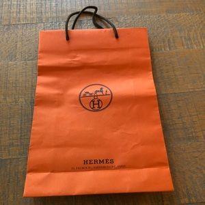 Hermès shopping bag.